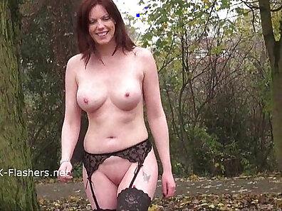 Beautiful redhead masturbating with dildo outdoors