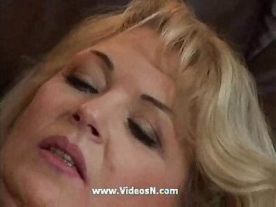 Busty Mom titty fucks son on the bed
