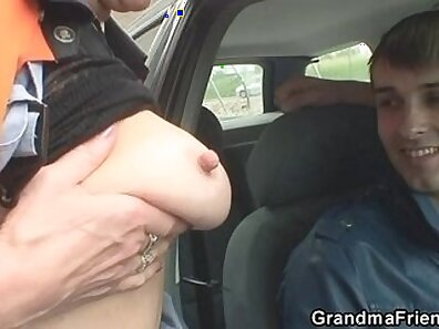 Slutty granny stroking and sucking huge cock