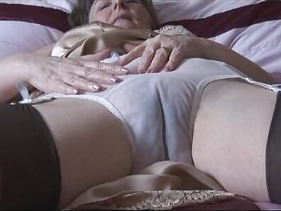 Hairy Granny beauty is pissing her panties on the bed