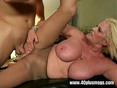 Stunning busty mature hottie flaunting her pussy piercing