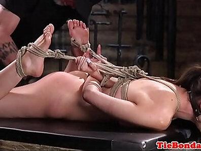 Bondage sub vibrating on floor