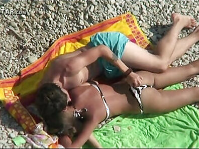 Playing with mother Topless On the Beach