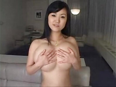 Beautiful Japanese chick with tanned skinika with natural boobs